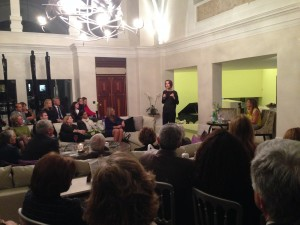 Elif Şafak speaking to attendees at a literary evening in support of the Galilee Foundation